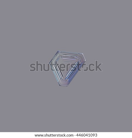 Snowflake isolated on uniform grey background: macro photo of real snow crystal, captured on glass. This is small snowflake of triangular plate type, with simple pattern of straight lines and ridges. - stock photo