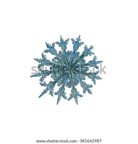 Snowflake isolated on white background for design. This is real snowflake macro photo (rare 12-sided snow crystal), captured on glass with LED back light. - stock photo