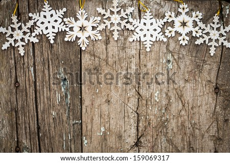 Snowflakes border on grunge wooden background. Winter holidays concept - stock photo