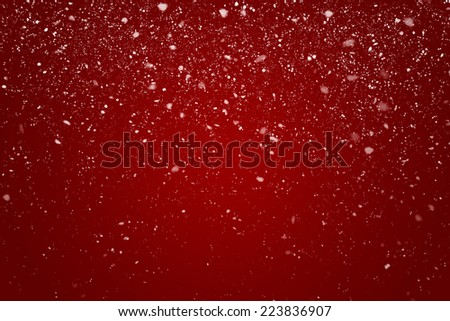 Snowflakes in Front of a Red Background with Vignette - stock photo