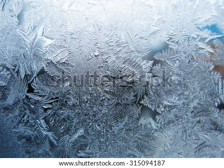 snowflakes ornament on glass winter texture background - stock photo