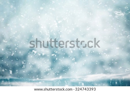 Snowing in winter time with wooden table for object - stock photo
