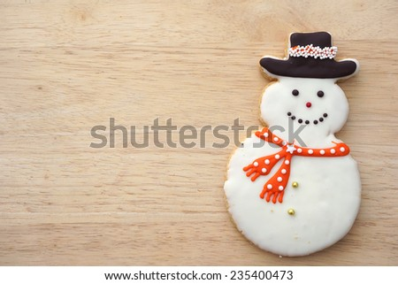 Snowman Cookie on Wood Background - stock photo