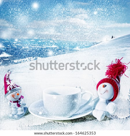 Snowman drinking coffee - stock photo