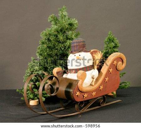 snowman in sleigh - stock photo