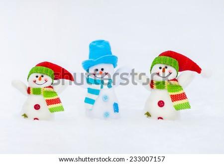 Snowman on snow. Christmas decoration. Family - stock photo