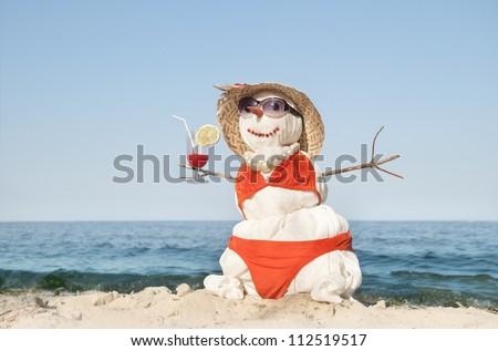 Snowman on the beach - stock photo