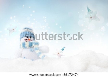 Snowman toy on the bokeh winter background - stock photo