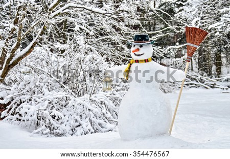 Snowman with broom  - stock photo