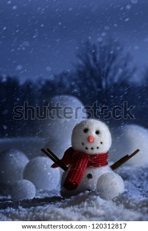 Snowman with winter night background - stock photo