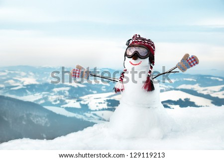 Snowmen at the mountains with mask - stock photo