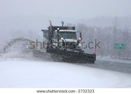 snowplow in action - stock photo