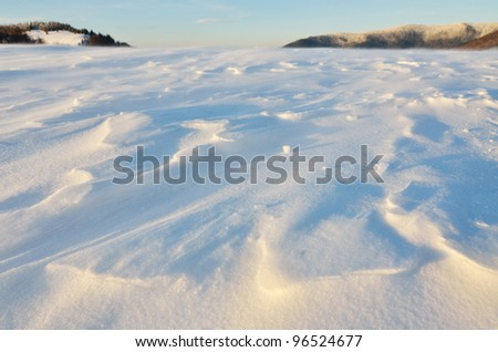 Snowscape close up in the mountains in lights of setting sun - stock photo