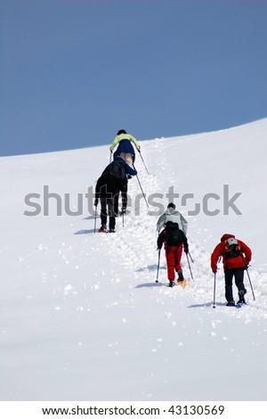 Snowshoe hiking. Alps, Italy. Winter - stock photo