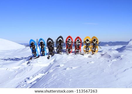 Snowshoeing. Snowshoes in the snow. - stock photo