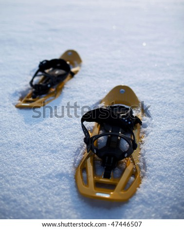 snowshoes in snow on a lovely yet frosty winter day - stock photo