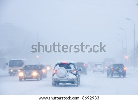 Snowstorm, poor visibility,slick roads and lots of traffic. - stock photo