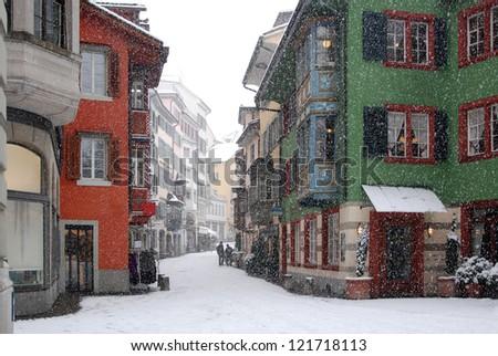 Snowy alley in Zurich - stock photo