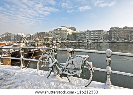Snowy Amsterdam at the Amstel in the Netherlands - stock photo