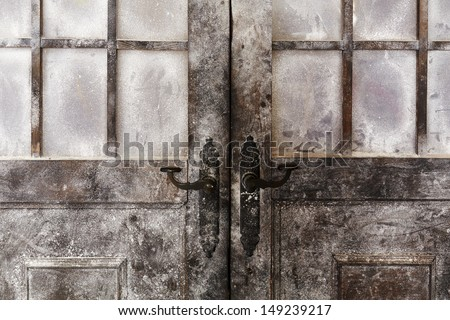 Snowy and icy decorated old styled doors - stock photo