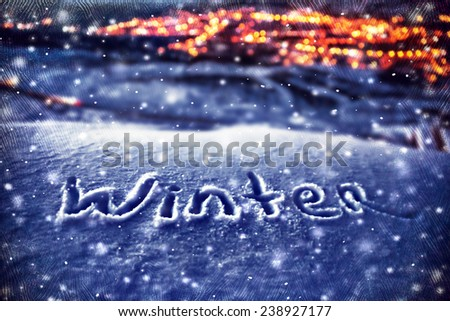 Snowy Christmas background, handwriting on the snow, beautiful winter nature at night, Xmas holidays theme, dark textured photo, selective focus on the text  - stock photo