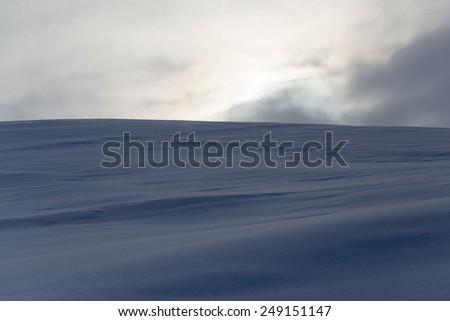 snowy field at sunrise - stock photo