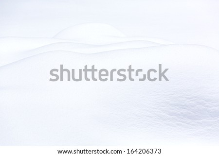 Snowy hills in frosty sunny day - stock photo