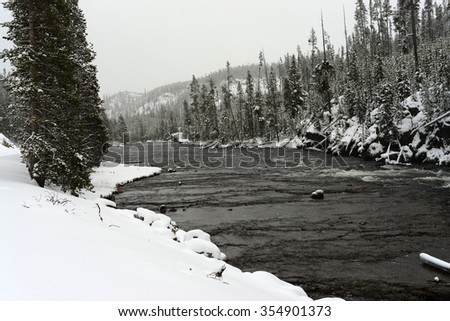 Snowy Morning on the Madison River in Yellowstone National park - stock photo