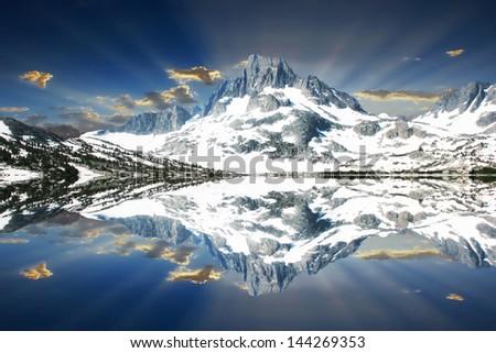 Snowy Mount Davis reflected on Thousand Island Lake. - stock photo