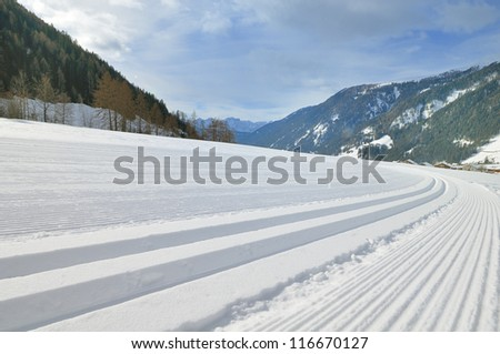 Snowy mountain landscape with cross country ski track in high Val Casies (Gsiesertal) in Alto Adige, Italy - stock photo