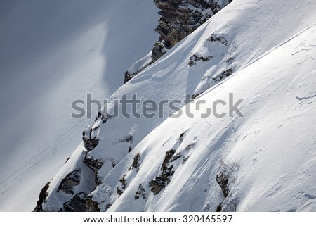 Snowy mountain slope. Winter landscape - stock photo