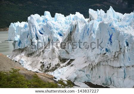 Snowy Perito Moreno glacier with the dark background - stock photo