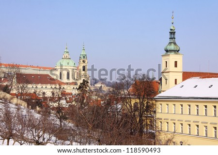 Snowy Prague St. Nicholas' Cathedral in the sunny Day, Czech Republic - stock photo