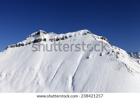 Snowy rocks in sun day. Caucasus Mountains, Georgia. Ski resort Gudauri. - stock photo