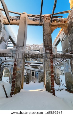 Snowy skeleton of the destroyed building - stock photo