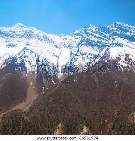 Snowy Tibetan mountains, view from Annapurna trek - stock photo