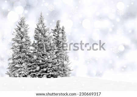 Snowy trees with twinkling silver background and snowflakes - stock photo