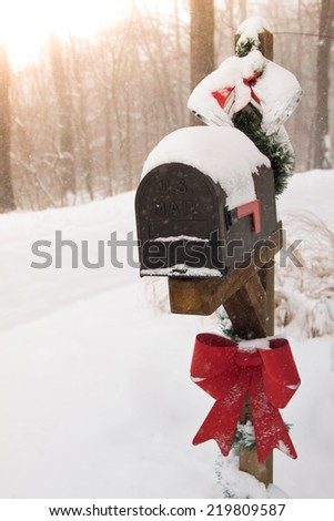 Snowy U.S. Mail box decorated for Christmas - stock photo
