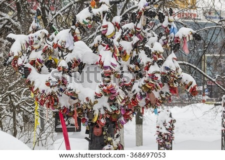 "Snowy wedding tree. Padlocks written Russian names and ""together forever"". - stock photo"