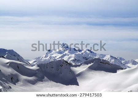 Snowy winter mountains. Caucasus Mountains. View from ski slope Elbrus. - stock photo