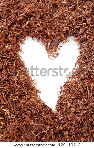 Snuff pipe forming a heart - stock photo