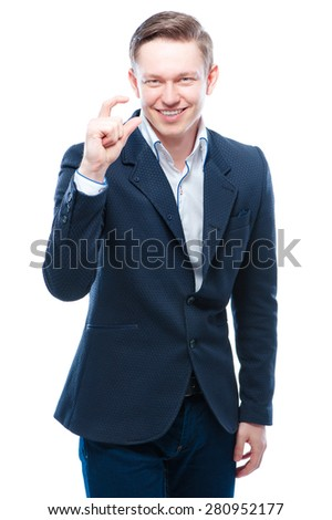 So small! Young attractive businessman showing size with fingers. Isolated on white. - stock photo