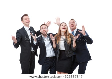 So wonderful! Group of exciting businesspeople looking up and gesturing while expressing positivity. Isolated on white. - stock photo