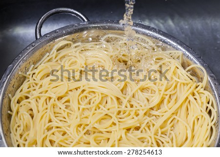 Soaking and prepare spaghetti in kitchen sink - stock photo