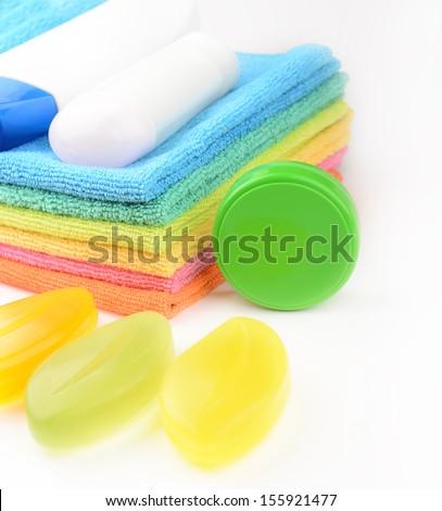 soap and towel, shampoo, face cream - stock photo