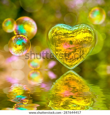 Soap bubble in the shape of a heart with reflections - stock photo