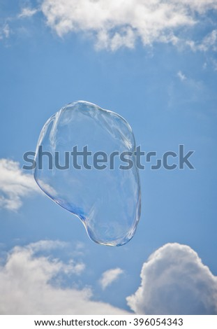 Soap bubble on the sky - stock photo