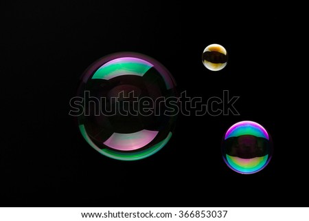 Soap bubbles on a black backgound for overlay use - stock photo