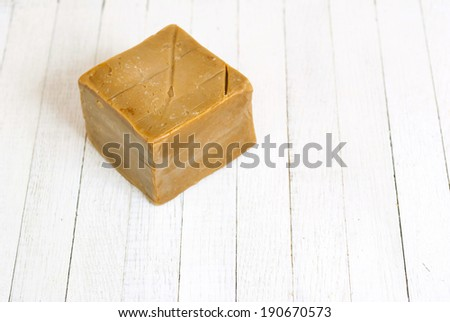 soap on white wood table - stock photo