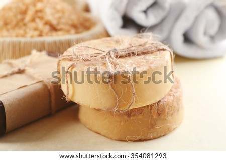 Soap set and salt on a beige background, close up - stock photo